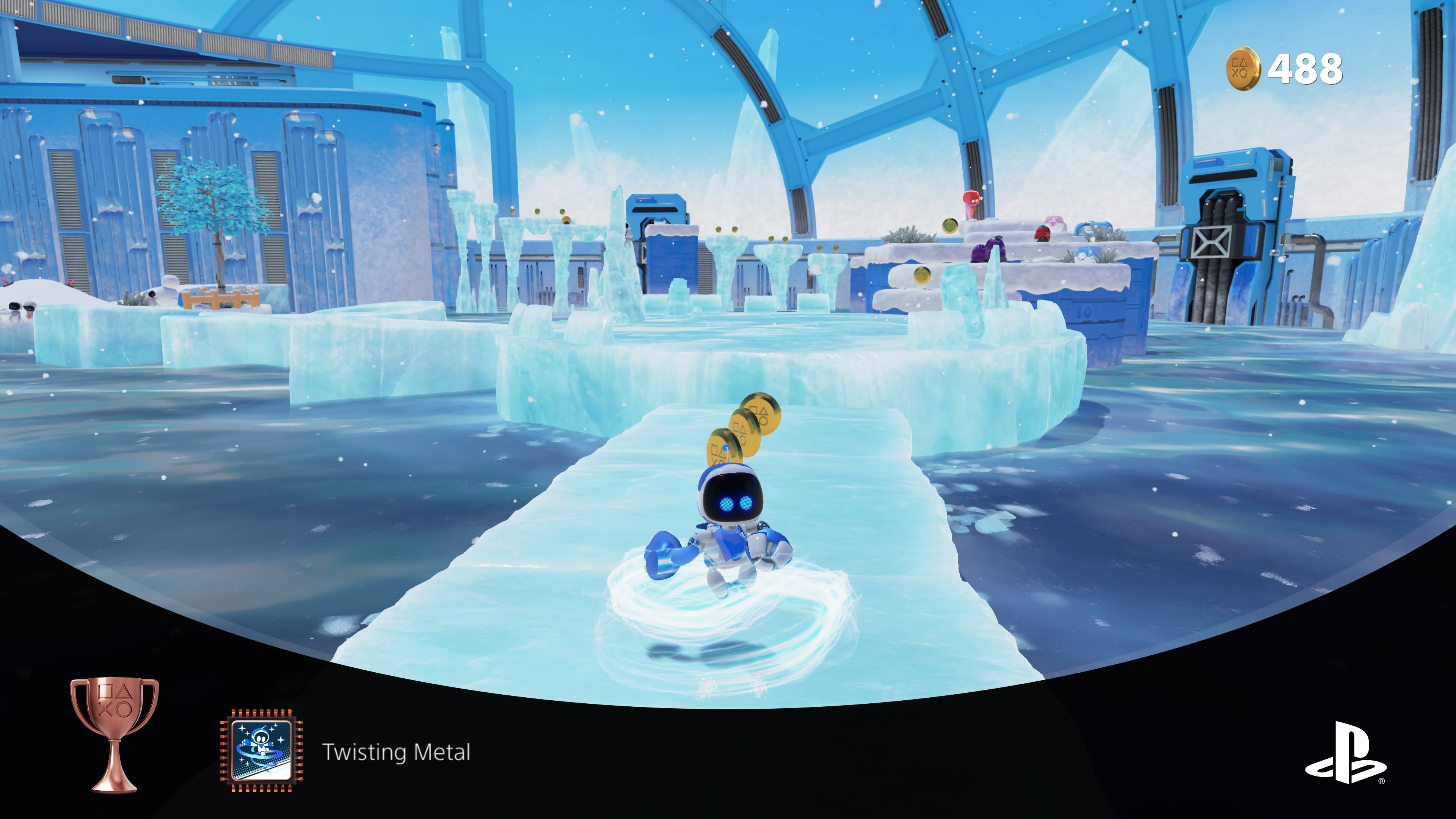 A screenshot of the game Astro's Playroom. It's a frozen level with ice blocks to walk on and freezing water below.