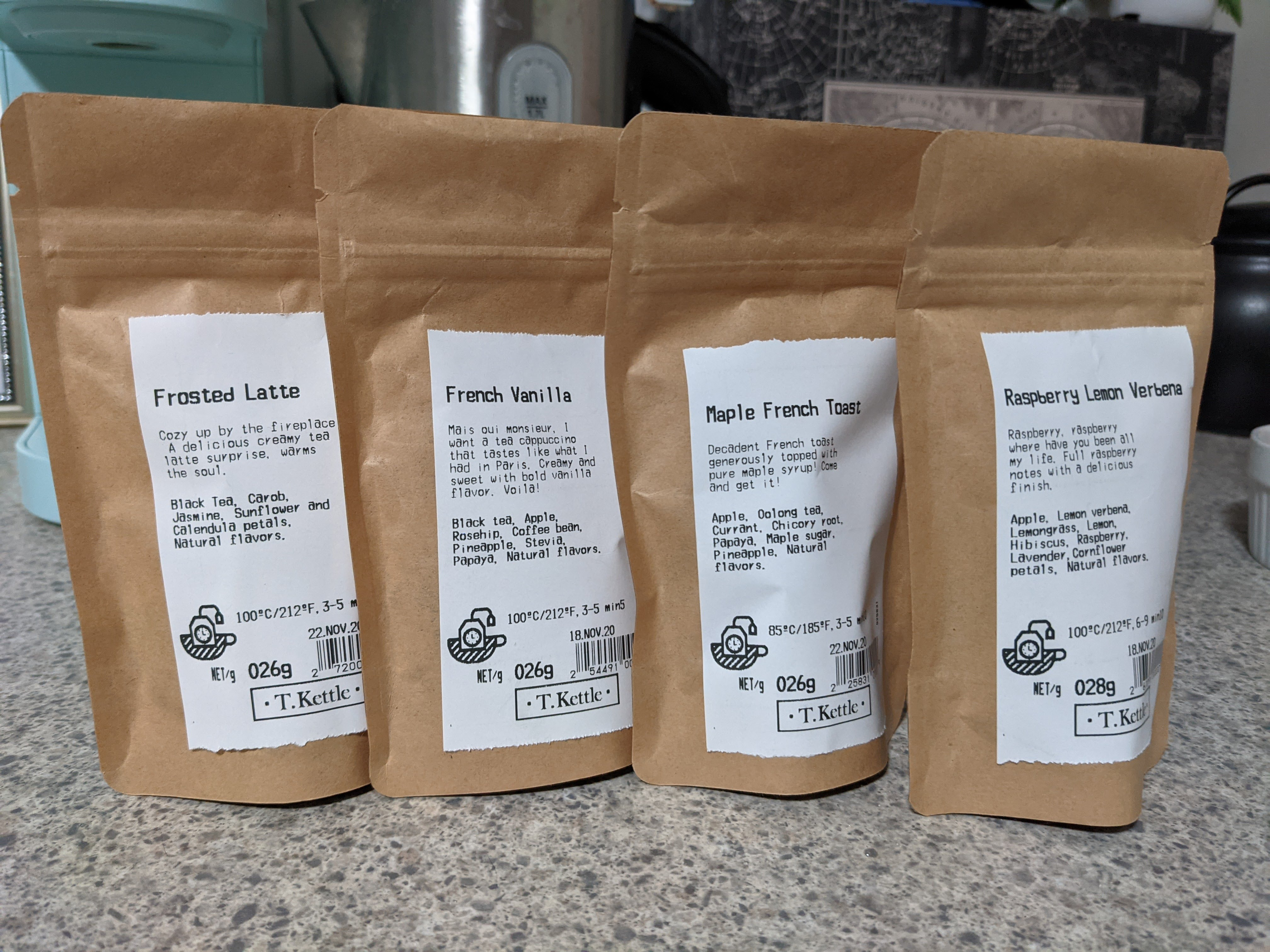 Four brown bags of tea, their names listed in order in the paragraph below.