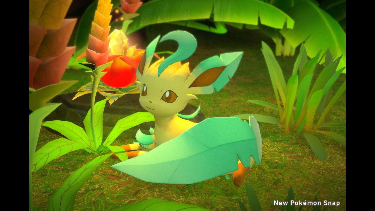 A Leafeon laying down next to a glowing flower.